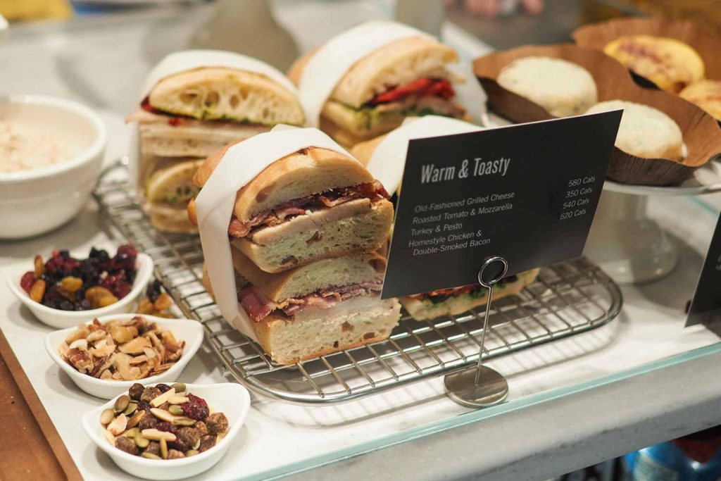 Starbucks food display with sandwiches and pastries