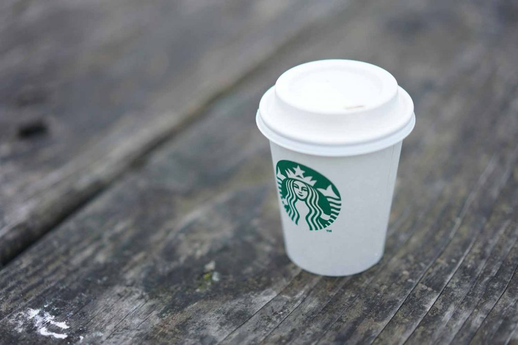 Starbucks cup on a wood surface